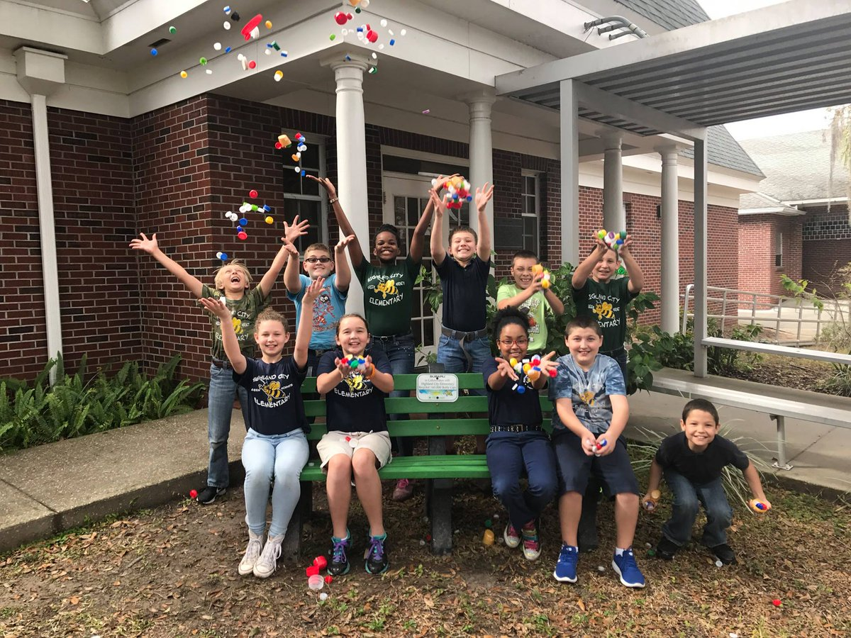 Students at Highlands City Elementary sitting on bench and having fun